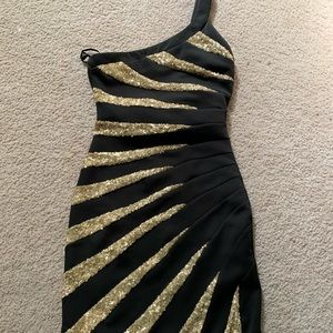 Worn once BEBE one shoulder dress with gold sequin